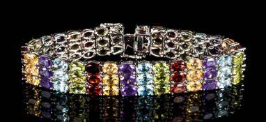 Amethyst, Red Garnet, Peridot Multi-Gemstone Bracelet, comprising three rows of of oval cuts in