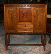 Jacobean Style Carved Oak Cabinet Central Slope Above 2 Drawers Between Two Cupboards, Raised On