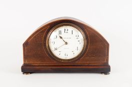 A 1920's Oak Cased 8 Day Mantle Clock raised on 4 circular brass feet with white porcelain dial