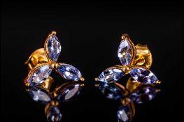 Tanzanite Marquise Cut Stud Earrings, each comprising three marquise cut tanzanites, the single