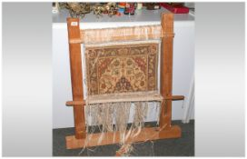 Small Persian Carpet, fixed to a wooden loom frame. Showing the technique of carpet making. 36''