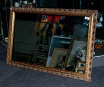 Large Gilt Framed Mirror in The French Style, with ornate moulded edge. 30x48''
