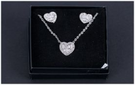 White Austrian Crystal Heart Necklace and Earrings Set, a heart shaped pendant comprising baguette