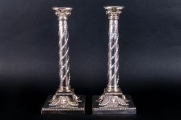 Elkington & Co Very Fine Pair of Silver Plated Candlesticks, Raised on Square Sloped Bases with Rams