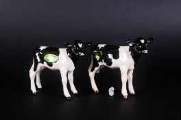 Beswick Animal Figures ( 2 ) In Total. ' Frisian Calf ' Black and White Gloss. Model Num.1249C.