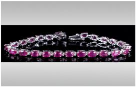 Ruby Tennis Bracelet, 18cts of rubies with a deep fuchsia pink undertone, oval cut and set in silver