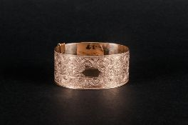 Antique 9ct Gold Front & Back Ornate Chased Bangle marked 9ct gold. Front & back.