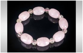 Rose Quartz and Prehnite Bracelet, faceted ovoid beads of rose quartz interspaced with small round