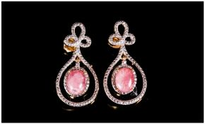 Rhodochrosite Pair of Drop Earrings, two oval cut cabochons of the unusual semi-precious, rose