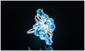 Swiss Blue Topaz Lozenge Cluster Ring, a total of eight oval cut Swiss blue topaz, set in a