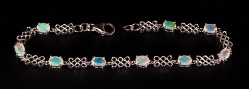 Opal Trellis Pattern Bracelet, nine oval cut, faceted opals, with good displays of colour,
