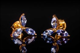 Tanzanite Marquise Cut Stud Earrings, each comprising three marquise cut tanzanites, the single