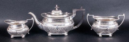 Edward VII Fine Silver Three Piece Tea Service Of Regency Form with half fluted decoration & pie-