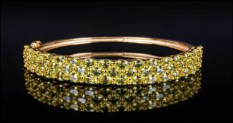 Peridot Three Row Bangle, 11.75cts of bright, sparkling, oval cut peridot, set in three horizontal