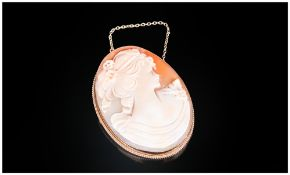 A Fine Quality Shell Cameo Brooch, Oval Shaped set in a 9ct gold mount. Hallmark London 1970.