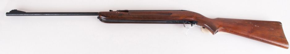 A Vintage 22 Cal. Airsporter Rifle. Features Tap Loader and Under lever. Number CD.1335. 44 Inches