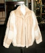 Ladies Blonde Mink Fur Jacket, Fully lined, Collar with revers, hook & loop fastening, slit pockets.