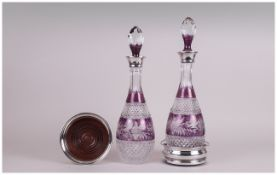 A Very Fine Pair of Silver Collared Cut Glass Decanters in purple and clear colourway complete