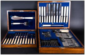 Two Wooden Cased Canteens Of Cutlery