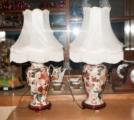 Pair Of Ceramic Table Lamps the bases with floral decoration & berries on white ground. Both with