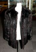 Ladies Dark Brown Three Quarter LEngth Mink Coat, fully lined , slit pockets. Collar with revers