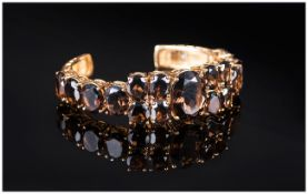 Smoky Quartz Bangle, 67.5cts of the rich dark coffee toned smoky quartz, the central oval cut