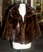 Ladies Dark Brown Mink Jacket, fully lined. collar with revers. slit pockets.