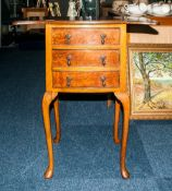 Early 20thC Walnut Bedside Cabinet The Shaped Top With Drop Leaves Above 3 Long Drawers Raised On