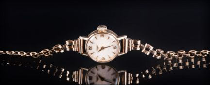 Longines Ladies 9ct Gold Watch, with Attached 9ct Gold Bracelet. Fully Hallmarked for London 1977.