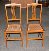 Two Bedroom Chairs with rush seats and tapering legs.