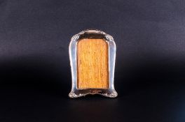Early 20thC Silver Photo Frame Of Shaped Form With Floral Embossed Decoration And Moulded Edge,