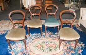 A Set of Four Victorian Carved Walnut Balloon Back Chairs. Each 35 Inches High. Overall Good