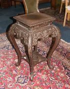 Oriental Hardwood Jardiniere Stand, Carved Square Top And Shaped Carved Frieze Raised On Long