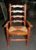 Small 19thC Ladder Back Child's Chair with angular arms, step ball feet and rush seat. c 1880. 30