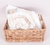 Basket of Assorted Linen including napkins, covers and table cloths.