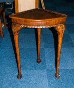 An Oak 1920's Corner Hall Table with beaded borders supported on 3 legs with ball and claw feet.