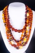 Collection of Amber Necklaces, a good selection comprising four ovoid, round and freeform