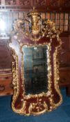 Large French Style Shaped Mirror, Gilt Painted Acanthus And Scroll Carved Decoration. 62 x 33