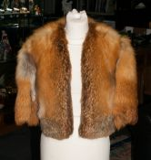 Red Fox Bolero with lining. With short sleeves and suede insert to under arm. Approx size 10-12.
