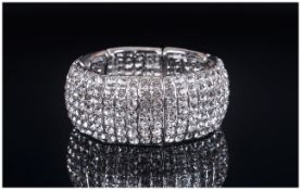 White Austrian Crystal Seven Row Bracelet, a panelled stretch bracelet, fully studded with brilliant