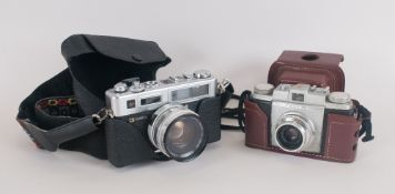 Yashica Electro 35 Camera complete with fitted case and strap. With skylight (1A) zoom lens. Plus