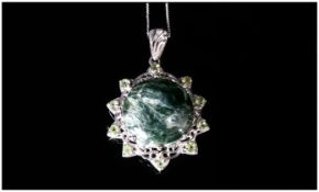 Siberian Seraphinite and Peridot Pendant, a large, round cut seraphinite of 11.75cts, with a good
