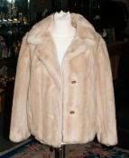 Ladies Faux Fur Short Jacket with slit pockets and rever collar.