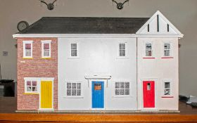 Large Dolls House made of wood and decorated throughout with a fitted bathroom, the other rooms