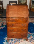 A 18th Century Walnut Bureau. The Fall Enclosing an Interior with Drawers, Cupboard and Pigeonholes,