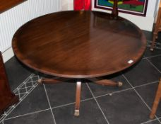 A Reproduction Mahogany Georgian Style Low Coffee Table supported by a pedestal base on four legs.