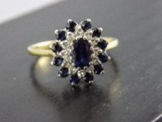 18 Carat Gold Set Diamond and Sapphire Cluster Ring with flower head setting, Fully hallmarked.