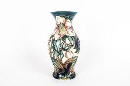 Moorcroft - Fine Tubelined and Shaped Vase ' Ashwood Hellebore ' Design. Designer Nicola Slaney.