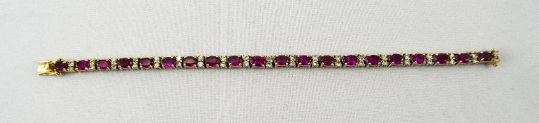 Silver Gilt Tennis Bracelet Set With 19 Ruby Red Coloured Stones Between Clear Faceted Spacers,