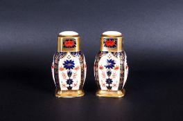 Royal Crown Derby Imari Patterned Pair of Salt and Pepper Pots. Pattern Num 1128. Date 1991. Plastic